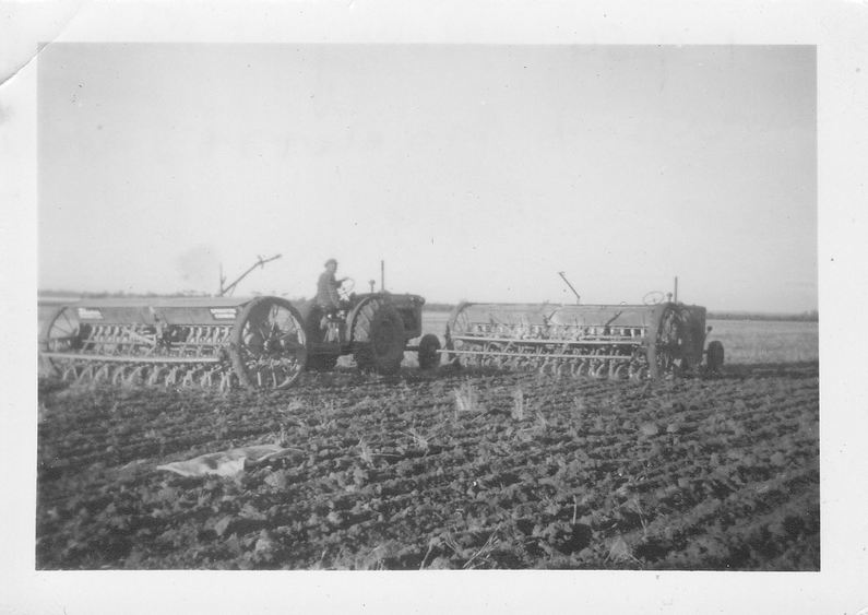 Faulkner collection: Seeding with 2 tractors and combines