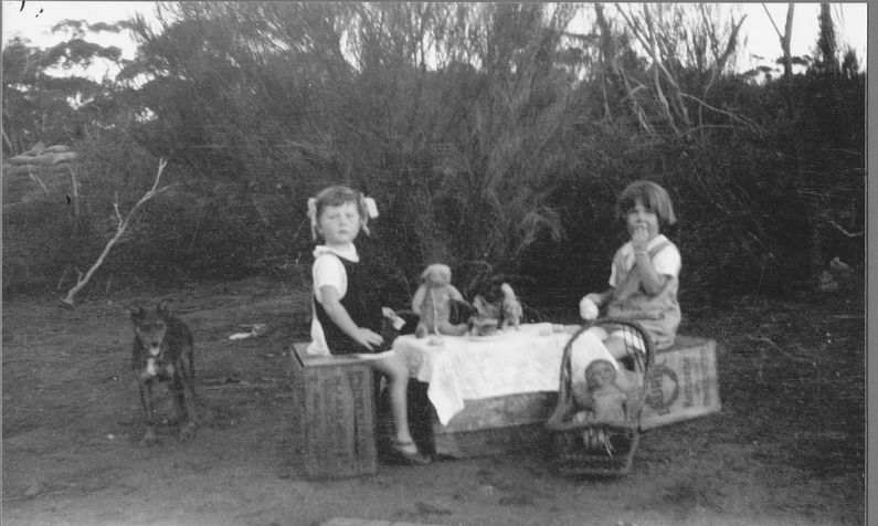 Fabulous old photo of two little girls having a tea party